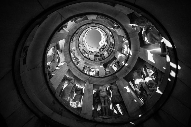 Low angle view of people on staircase