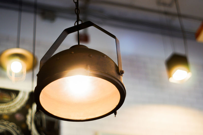 Illuminated Lighting Equipment Low Angle View No People Focus On Foreground Indoors  Light Glowing Close-up Light Bulb Hanging Electric Light Metal Electric Lamp Pendant Light Electricity  Light - Natural Phenomenon Geometric Shape Technology Ceiling