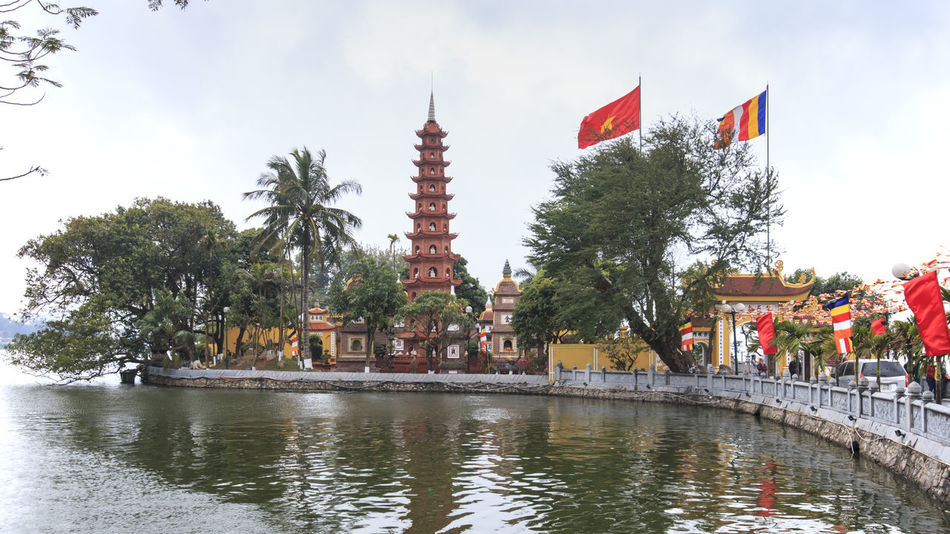 Hanoi, Vietnam: February 23, 2016: Tran Quoc pagoda, the oldest Buddhist temple in Hanoi. Architecture ASIA Built Structure Cloud Cloud - Sky Day Famous Place Hanoi Vietnam  Ho Chi Minh Mausoleum Hoan Kiem Lake Landmark One Pillar Pagoda Outdoors People Sky Tourism Tourists Traffic Traffic Jam Tran Quoc Pagoda Travel Destinations Tree Vietnam Water