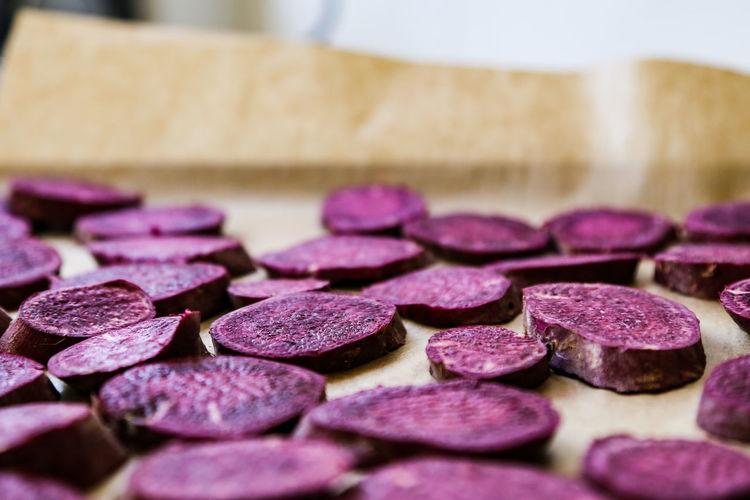Close-up of chopped sweet potato on cutting board