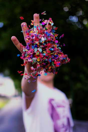 Close-Up Of Man With Multi Colored Confetti
