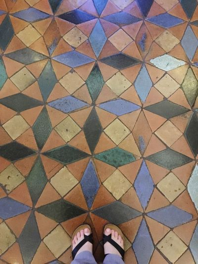 Pattern Multi Colored Personal Perspective Low Section Human Leg Tiled Floor Flooring Standing Indoors  Close-up Medieval Architecture Ancient Floor Decoration