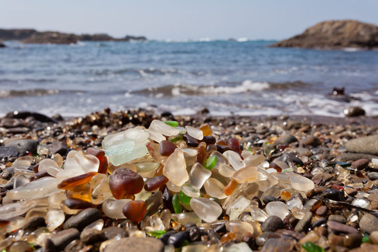 Pile of rounded glass shards or sea-glass of Fort Bragg, California, US with blurry Pacific Ocean background Seaglass Sea Glass Sea Glass Shore Fort Bragg Fort Bragg, California Pacific Shore Beach California California Coast Coast Coastal Travel Travel Destinations Destination Pebbles Treasure Sherds Glass Washed Up Weathered Ocean Sea USA Attraction Land Water Nature No People Beauty In Nature Large Group Of Objects Horizon Sand Outdoors Scenics - Nature Horizon Over Water Close-up Garbage Pebble Pollution