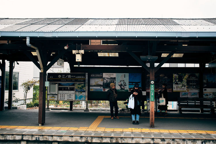 People at railroad station