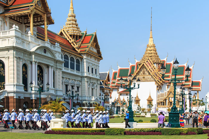 Bangkok, Thailand - April 14,2015: Tourists visiting the the Grand Palace Architecture Built Structure Capital Cities  City City Life Day Façade Famous Place Grand Palace Bangkok Thailand Grass Large Group Of People Leisure Activity Lifestyles Mixed Age Range Outdoors Place Of Worship Sky Spirituality Tourism Tourist Travel Destinations