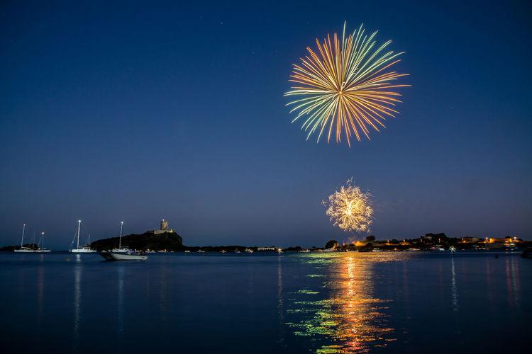 Fireworks over the sea of nora bay, sardinia