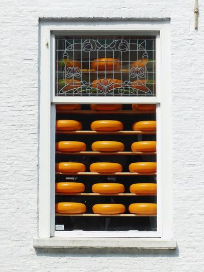 | cheesy window | 😂 backside of a cheese shop in Delft, Netherlands Cheese Cheese Wheel Window Weird Window More Cheese Please Gouda Orange Orange And White Holland Typical Dutch Cheese! White Wall Pattern Pattern Pieces Pattern, Texture, Shape And Form