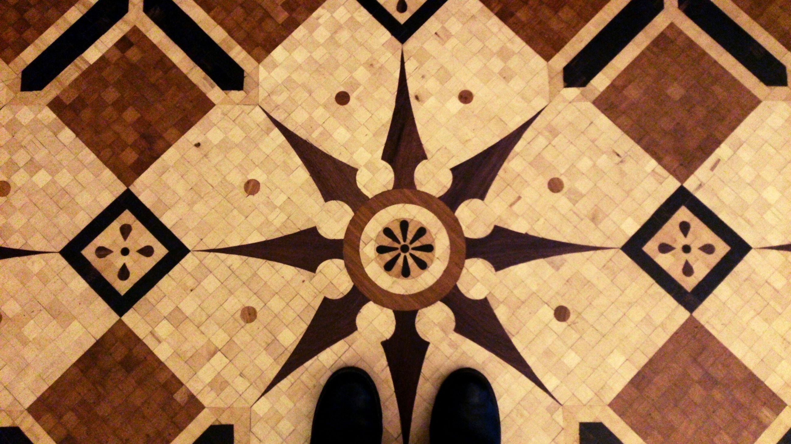 indoors, pattern, high angle view, circle, full frame, backgrounds, geometric shape, design, architecture, built structure, ceiling, flooring, repetition, tiled floor, directly above, shape, no people, art and craft, tile, in a row
