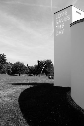 Love Vitra Design Museum Weil Am Rhein Architecture Black And White Blackandwhite Built Structure Cloud - Sky Communication Day Field Grass Land Nature No People Outdoors Park Plant Shadow Sign Sky Sunlight Text Tree Vitra Museum The Architect - 2018 EyeEm Awards