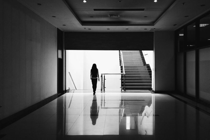 Woman walking towards staircase