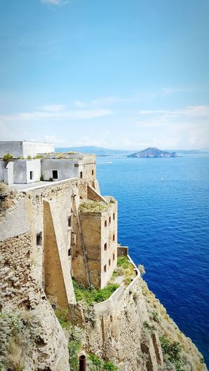I Architecture Built Structure Blue Sea Water Building Exterior Horizon Over Water Sky Damaged Deterioration Day Outdoors Tranquility Fort Scenics Fortified Wall History No People Obsolete Cliff Italy🇮🇹 Naples