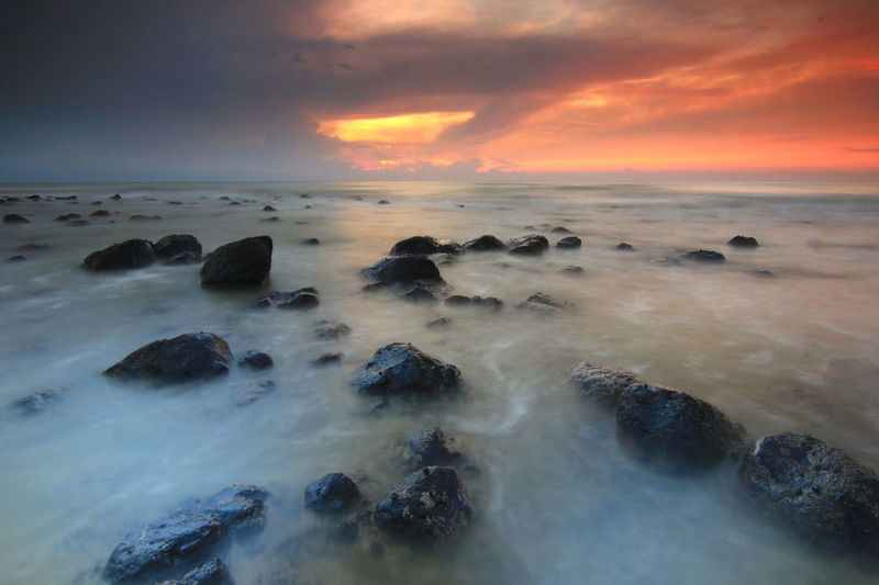 Dramatic Sky Cloud - Sky Sea Horizon Over Water Beach Outdoors Landscape Rock - Object Beauty In Nature No People Multi Colored Sunrise