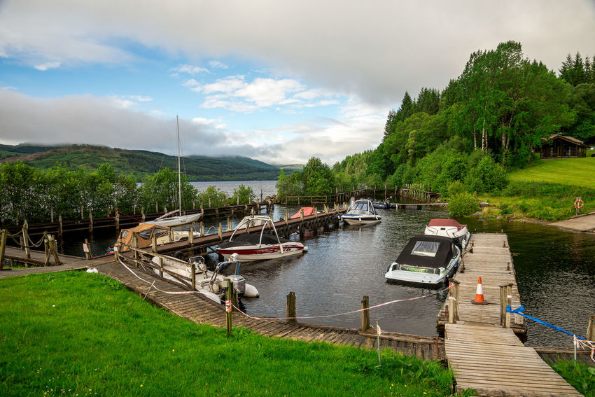 A small boat station at Loch Tay waterfront near Killin, central Scotland Boat Station Family Holiday Loch Tay Perthshire Pier Scenic Scotland Trees Boat Cloud - Sky Coast Cruising Fishing Highlands Jetty Killin  Lake View Lakeshore Outdoors Rental Vacation Water Wooden