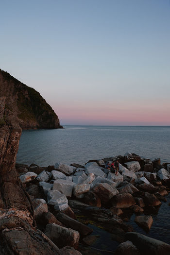 Soft rose sunset in Italy. Blue Hour Cinque Terre Ocean View Sunset_collection Beach Beauty In Nature Blue Hour Landscape Clear Sky Europe Horizon Over Water Italy Liguria Nature Non-urban Scene Ocean Outdoors Riomaggiore Rock Scenics - Nature Sea Sky Sunset Tranquil Scene Tranquility Water