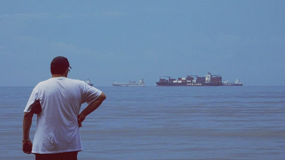 Rear View One Man Only Sea Only Men One Person Adults Only Standing Beach People One Young Man Only Adult Men Back Human Back Outdoors Day Young Adult Sky Ship Cargo Ship Costa Rica Puntarenas