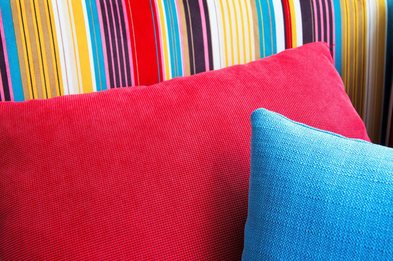 Close-up of multi colored sofa at home