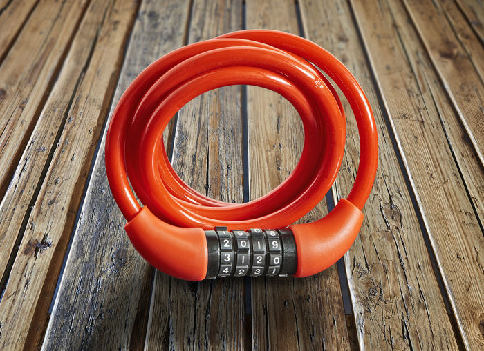 2019 New Year Locker Bike Brown Circle Close-up Day Focus On Foreground Geometric Shape High Angle View Life Belt Lock No People Orange Color Pattern Red Safety Security Still Life Table Wood Wood - Material
