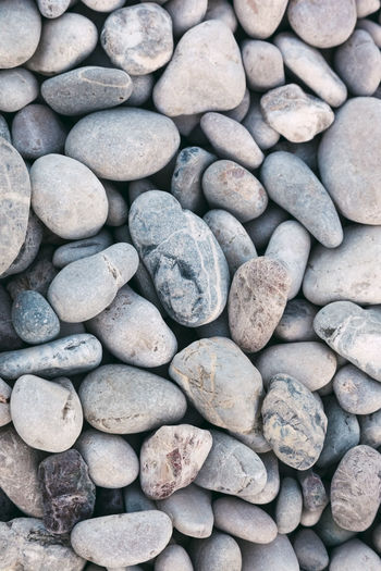 Close-up of pebbles on the beach - Olympos, Antalya Province, Turkey, Asia Directly Above Abstract Abstract Backgrounds Abundance Background Beach Pebble Pebble Beach Close-up Conformity Dry Geology Granite Gravel Gray Grey Harmony Stack Heap Hot Stone Japan Japanese Garden Kyoto Lastone Massage Material Meditation Mediterranean  Natural Beauty Natural Pattern Natural Order Pattern Pattern, Texture, Shape And Form Repetition Rock - Object Shape Simplicity Stone Textured  Texture Variation Türkiye Zen Zen-like Solid Stone - Object Large Group Of Objects Rock Backgrounds Full Frame No People Textured  Day Land Rough High Angle View Nature Outdoors