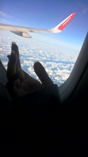 From An Airplane Window Sky And Clouds My Hand  AirPlane ✈ On The Sky Flying High