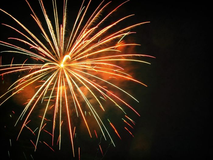 Fireworks display at night sky