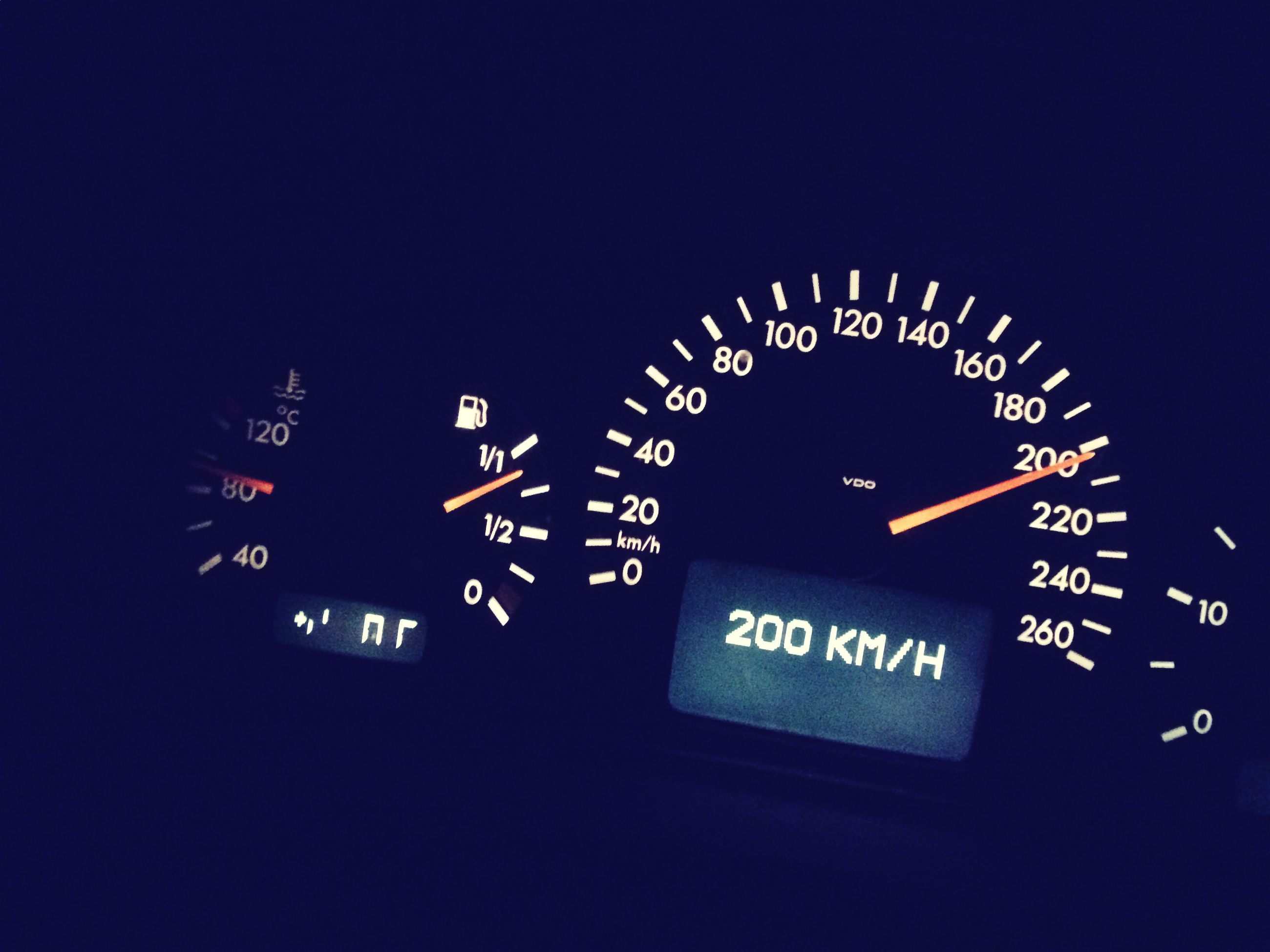 speedometer, transportation, text, number, illuminated, dashboard, no people, mode of transport, night, communication, control panel, land vehicle, car, blue, gauge, close-up, technology, outdoors