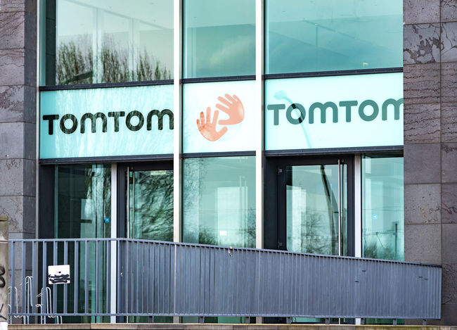 Berlin, Germany - March 11, 2018: Logo of the Dutch company TomTom that produces traffic, navigation and mapping products, action cameras, GPS sport watches, and fleet management systems Business Company Logo Sign Architecture Building Exterior Built Structure Close-up Communication Day Emblem  Navigator  No People Outdoors Symbol Text Tomtom Western Script