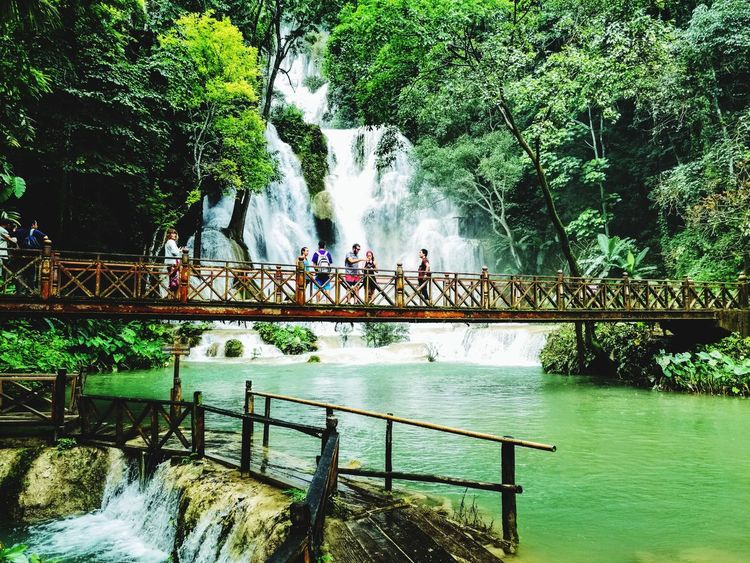 Railing Water River Real People Tree Men Outdoors Day Bridge - Man Made Structure Nature Women Lifestyles Standing Full Length Togetherness Footbridge People