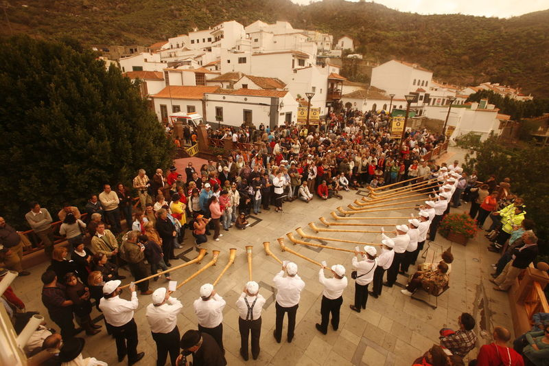 High angle view of men playing alphorn while performing at street