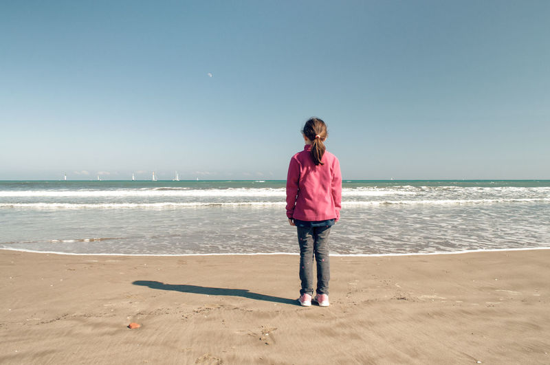 Young girl standing on a beach, watching the sea Kids Malvarrosa Malvarrosa Beach Moon SPAIN Tranquility Valencia, Spain València Winter Beach Child Day Horizon Horizon Over Water Kid Nature One Person Outdoors Real People Sand Sea Sky Standing Watching Water