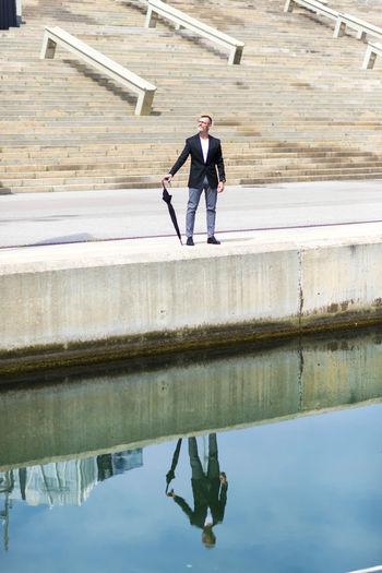Full length of man standing at harbor
