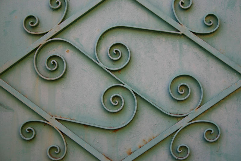 Ancient Elegant Iron Metal Door Painted Backgrounds Close-up Day Daylight Decoration Decorations Decorative Detail Full Frame Green Color Green Painted No People One Person Outdoors Pattern Spirals Surface Level Symmetrical Symmetry Textured