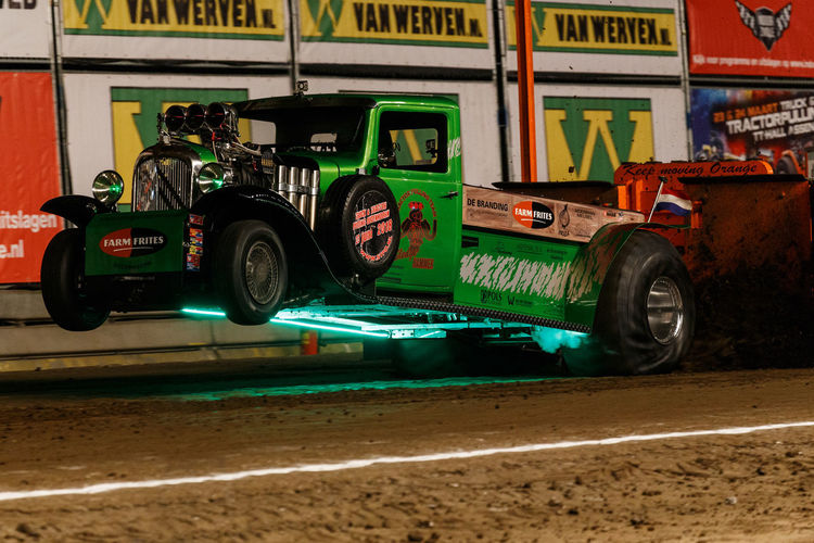 Jet Engine Supercharged  Tractor Tractor Pulling V-8 Auto Racing Competition Day Green Color Horsepower Land Vehicle Loud Mode Of Transport No People Outdoors Pull Racecar Sport Sports Race Tire Tractor Pull Transportation Turbo Wheelie