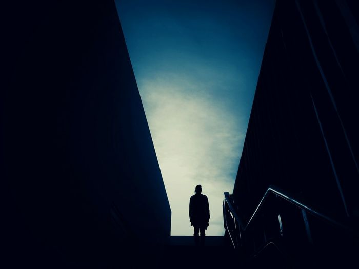 Silhouette of person standing on steps