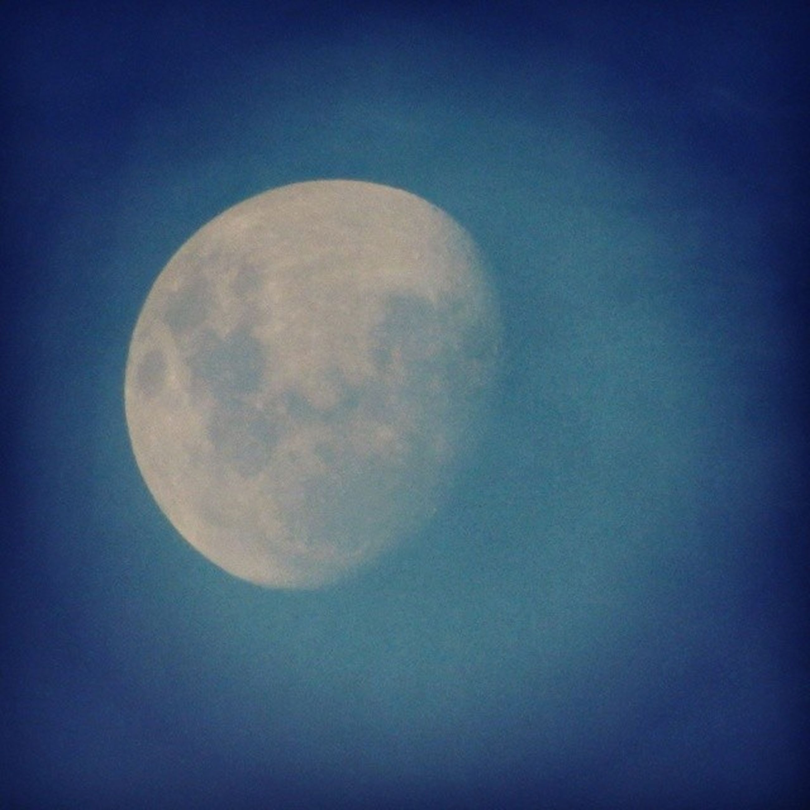 moon, astronomy, copy space, low angle view, full moon, planetary moon, sphere, circle, moon surface, discovery, night, beauty in nature, space exploration, blue, sky, tranquility, nature, scenics, tranquil scene, clear sky
