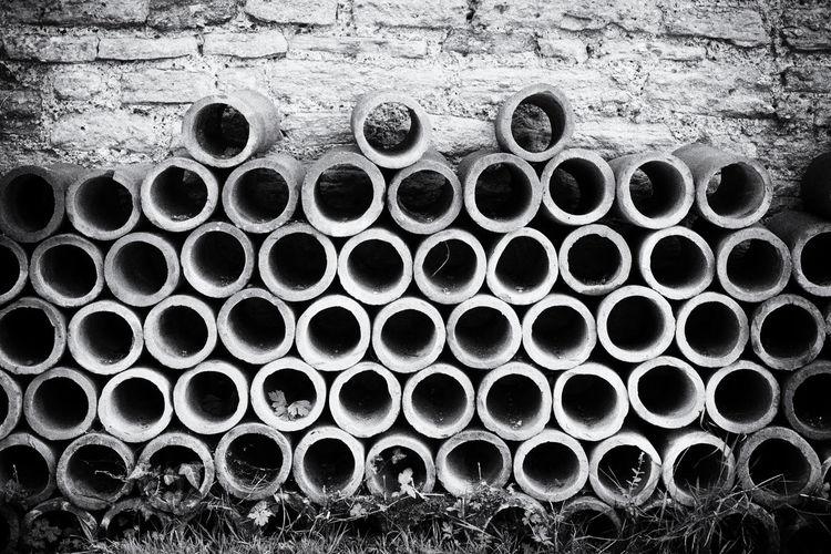 A pile of terracotta tubes I came across on a walk Arrangement Black & White Blackandwhite BLCK&WHT Geometry Pipe Pipe - Tube Stack Tube Tubes