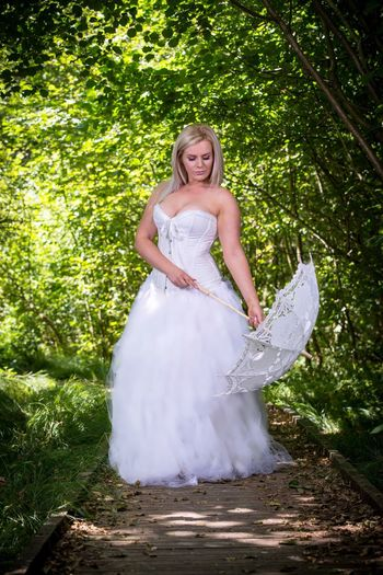 Smiling Happiness Plant Women One Person Looking At Camera Portrait Front View Wedding Dress Emotion Blond Hair Young Adult Fashion Standing Lifestyles Leisure Activity Nature Clothing Hair Beautiful Woman