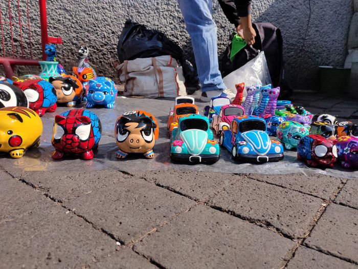 Low section of various toys on street