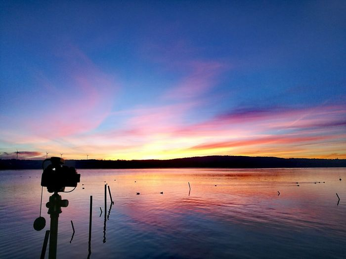Sunrise over Starnberg Lake Water Lake Reflection Nature Sky Outdoors Camera - Photographic Equipment No People Beauty In Nature HuaweiP9 sunrise Golden Hour Cold Temperature Tranquility Tranquil Scene Beauty In Nature Reflection Blue Sky Dawn Blue Hour Sunrise And Clouds Cloud - Sky Scenics Reflection Lake Long Exposure