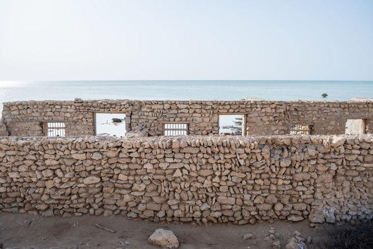 An abandoned fishing village located in al jumail, ruwais north of doha, qatar.