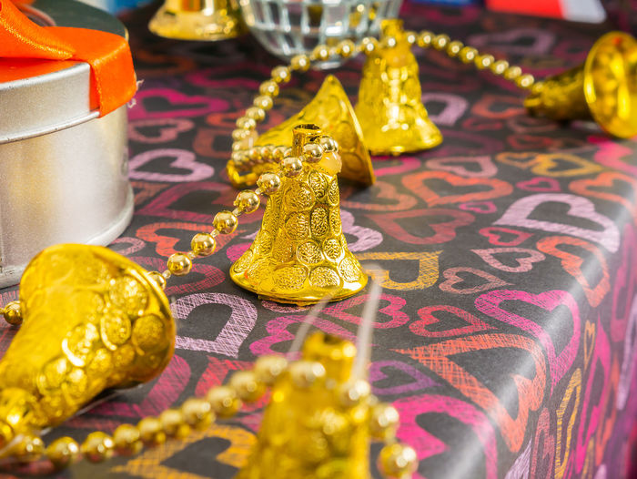 Close-Up Of Golden Bells On Table