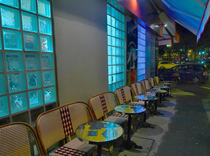 Multi colored chairs in illuminated room