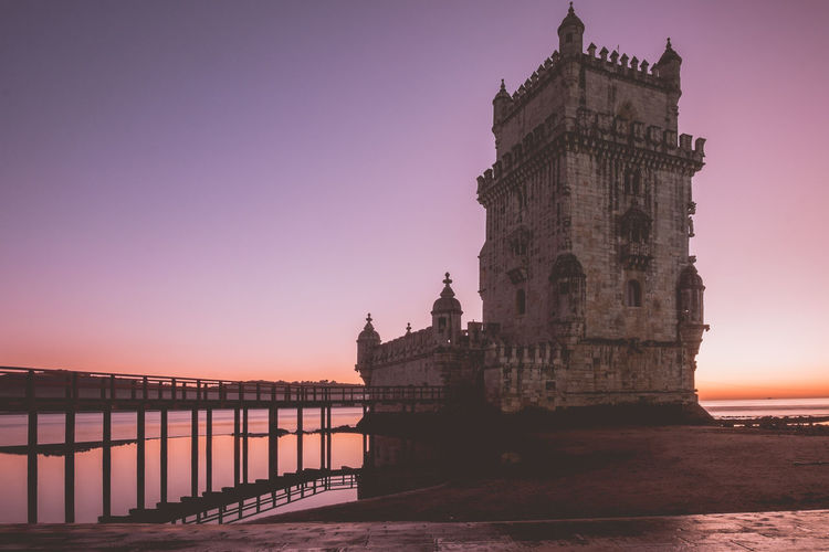 Long exposure capture of Belem Tower during sunset. Architecture Built Structure Travel Destinations Lisbon Portugal Europe Sky Sunset Water Building Exterior History Nature Travel The Past Tourism Sea Clear Sky No People Railing Scenics - Nature City Outdoors Purple