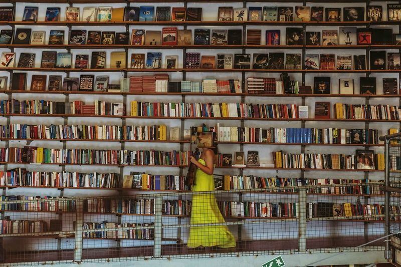 Can you find her face in the shelf? 😜 Shelf Abundance Book In A Row Large Group Of Objects Library Bookshelf Indoors  One Person Day People Cut And Paste Adult Bookstore