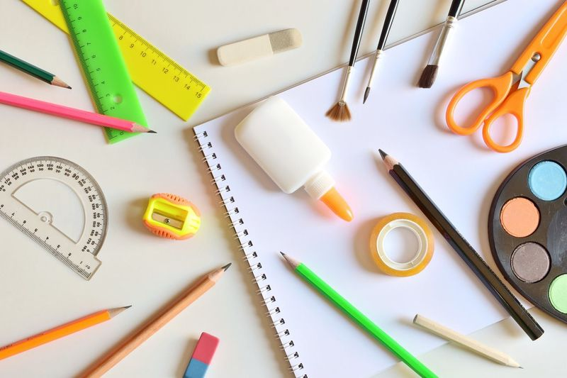 Directly above shot of various school supplies on table