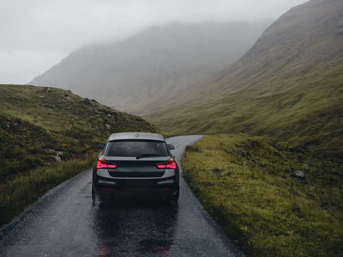 Car on road against mountains