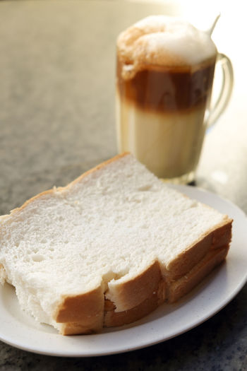 Close-up of bread and coffee served on table