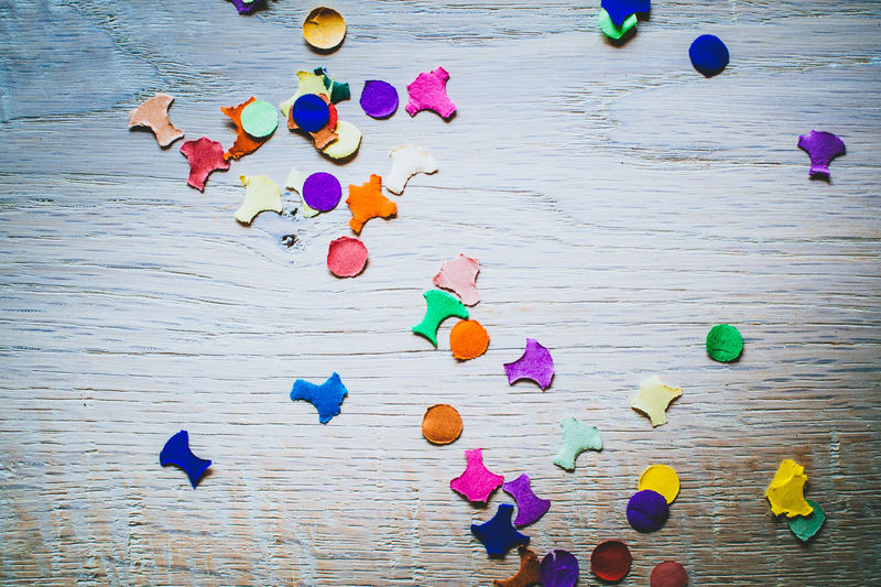 Directly above view of scattered colorful papers on table