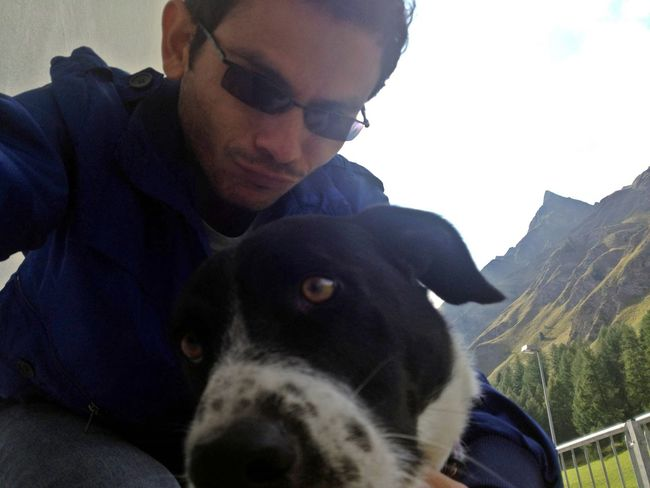 Pet Selfie Pet Portraits Pet Selfie Bonding Close-up Day Dog Domestic Animals Front View Leisure Activity Lifestyles Mammal Men Mountain Nature One Animal One Person Outdoors People Pets Portrait Real People Selfie Young Adult