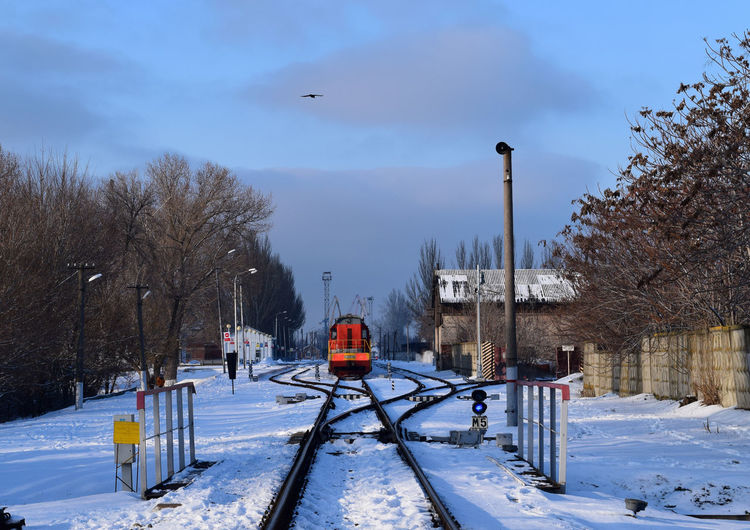 Railroad Track Train Tracks Bare Tree Beauty In Nature Cold Temperature Day Nature No People Outdoors Rail Transportation Railroad Station Railway Sky Snow Train - Vehicle Train Station Transportation Tree Weather Winter
