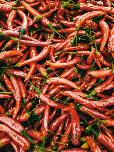 Full frame shot of red chili peppers for sale in market